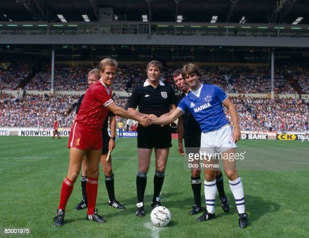 Liverpool captain Phil Neal shakes hands with Everton's Kevin Ratcliffe prior to the FA Charity Shield match at Wembley Stadium August 18th 1984 The...