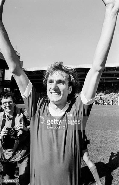 Liverpool captain Phil Thompson acknowledges the crowd before picking up the Football League Division One trophy after the Football League Division...