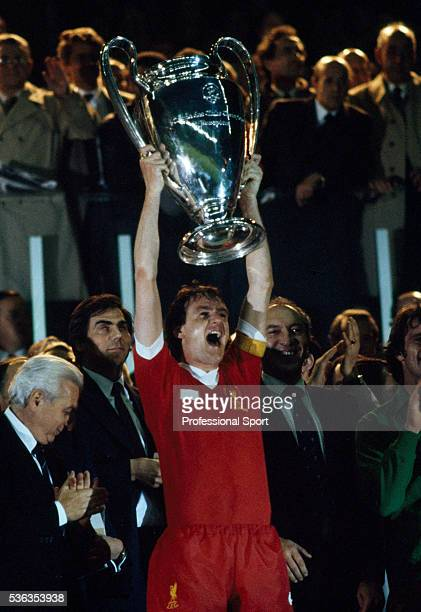 Liverpool captain Phil Thompson holds the European Cup aloft after the UEFA European Cup Final between Liverpool and Real Madrid at the Parc des...