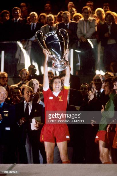 Liverpool captain Phil Thompson lifts the European Cup after his team's 10 victory