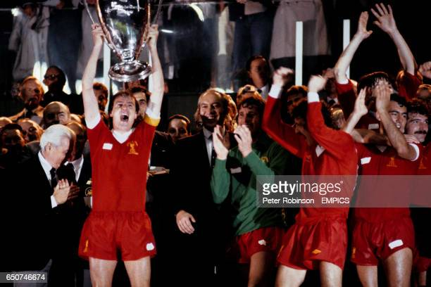 Liverpool captain Phil Thompson lifts the European Cup after Liverpool won the trophy for the third time in Paris