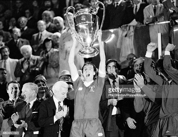 Liverpool captain Phil Thompson lifts the trophy after the presentation ceremony following their 10 victory over Real Madrid in the European Cup...