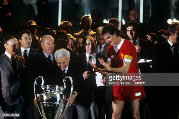 Liverpool captain Phil Thompson waiting to lift the European Cup trophy after his team's 10 victory