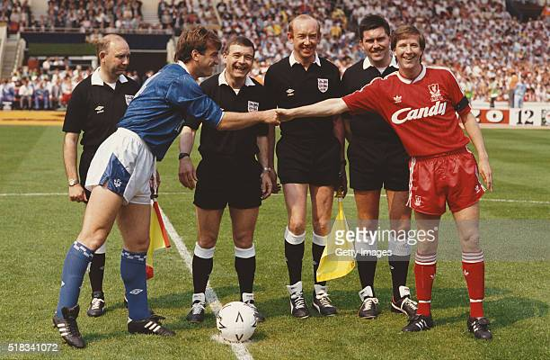 Liverpool captain Ronnie Whelan and Everton captain Kevin Ratcliffe share a joke before the 1989 FA Cup Final between Everton and Liverpool at...