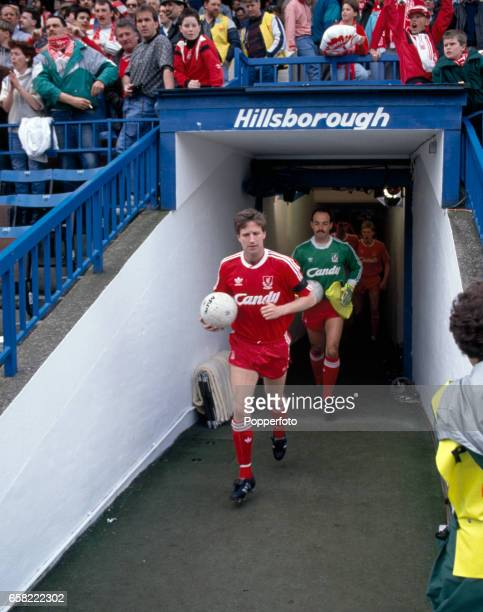 Liverpool captain Ronnie Whelan followed by goalkeeper Bruce Grobbelaar lead their team onto the field prior to their FA Cup SemiFinal match against...