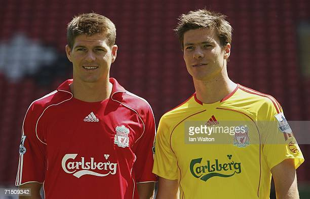 Liverpool captain Steven Gerrard and Xabi Alonso show off the new home and away kits during the Liverpool FC Adidas Kit Launch at Anfield on July 24...