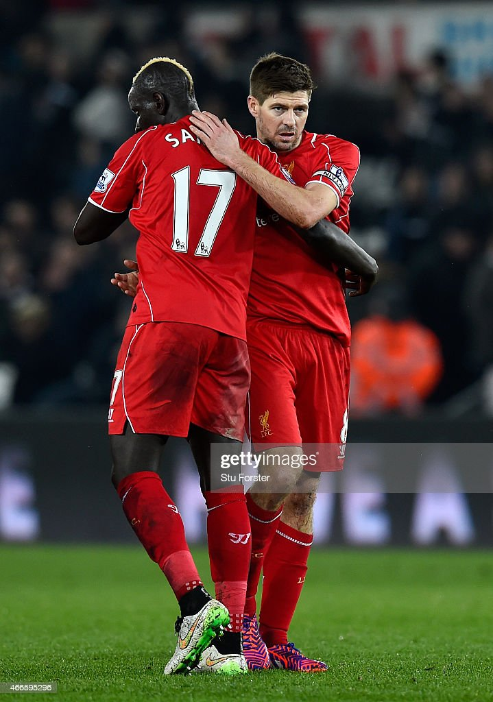 Liverpool captain Steven Gerrard (r) celebrates with Mamadou Sakho after the Barclays Premiership match between Swansea City and Liverpool at Liberty Stadium on March 16, 2015 in Swansea, Wales.