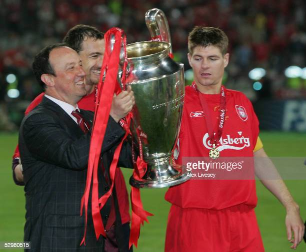 Liverpool captain Steven Gerrard goalkeeper Jerzy Dudek of Poland and Liverpool manager Rafael Benitez of Spain lift the European Cup after Liverpool...
