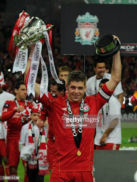 Liverpool captain Steven Gerrard holds the trophy aloft at the end of the Carling Cup Final match between Liverpool and Cardiff City at Wembley...