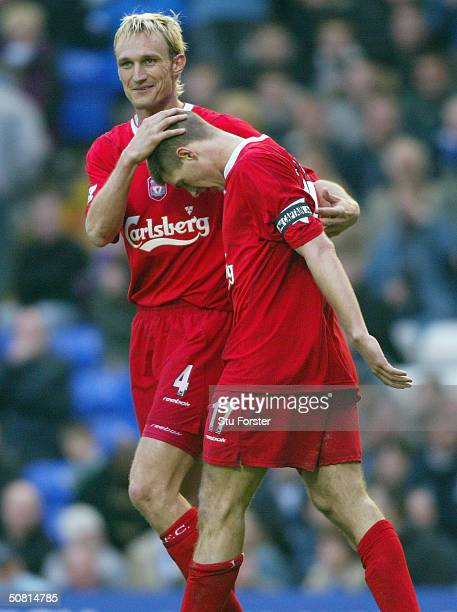 Liverpool captain Steven Gerrard is congratulated by Sami Hyypia after scoring the third goal during the FA Barclaycard Premiership match between...
