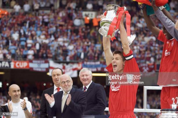Liverpool captain Steven Gerrard raises the FA Cup trophy after the final between Liverpool and West Ham United at the Cardiff Millenium Stadium on...