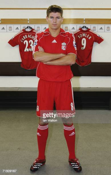67f631ffbdf Liverpool captain Steven Gerrard shows off the new home kit in the dressing  room during the