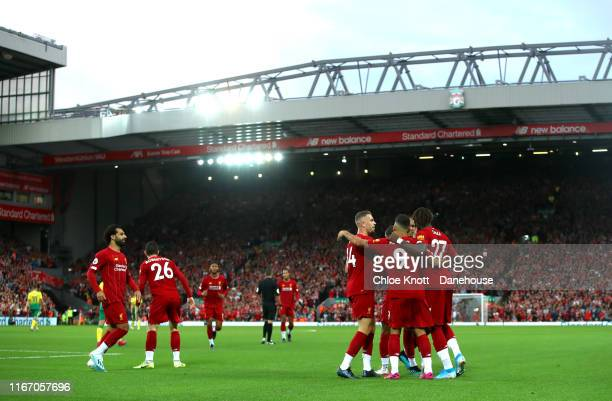 Liverpool celebrate after Grant Hanley of Norwich City scores a own goal during the Premier League match between Liverpool FC and Norwich City at...