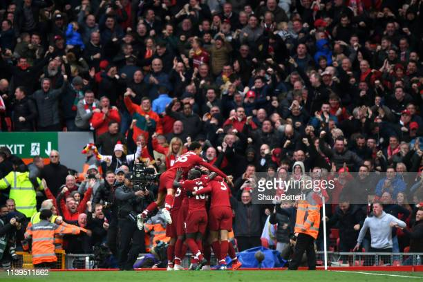 Liverpool celebrate their second goal during the Premier League match between Liverpool FC and Tottenham Hotspur at Anfield on March 31 2019 in...