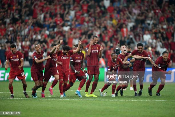 Liverpool celebrate victory following the penalty shoot out following the UEFA Super Cup match between Liverpool and Chelsea at Vodafone Park on...