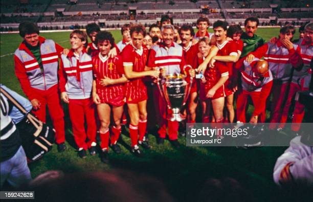 Liverpool celebrate with the trophy after winning the UEFA European Cup Final between AS Roma and Liverpool FC held on May 30 1984 at the Stadio...