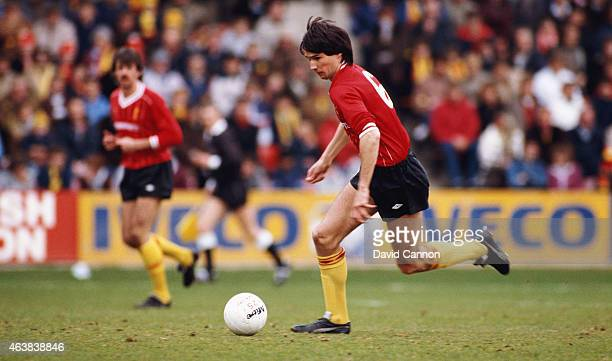 Liverpool centre back pairing Mark Lawrenson and Alan Hansen in action during a League Division One match between Watford and Liverpool at Vicarage...