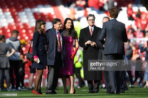 Liverpool Chairman Tom Werner Liverpool's US owner John W Henry and Linda Pizzuti Henry's wife are seen on the pitch at the end of the English...
