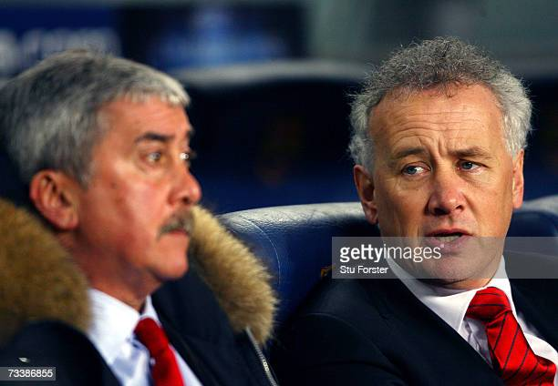 Liverpool Chief Executive Rick Parry and outgoing Chairman David Moores watch a UEFA Champions League round of 16 first leg match between Liverpool...