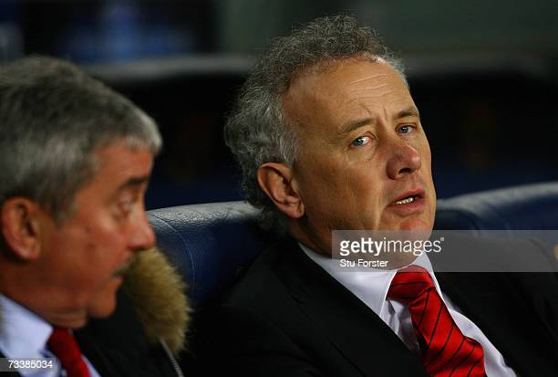 Liverpool Chief Executive Rick Parry speaks with outgoing Chairman David Moores during the UEFA Champions league Round of 16 first leg match at the...