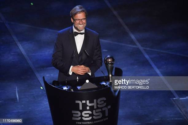 Liverpool coach, Germany's Juergen Klopp reacts after winning the trophy for the Best FIFA Men's Coach of 2019 Award during The Best FIFA Football...