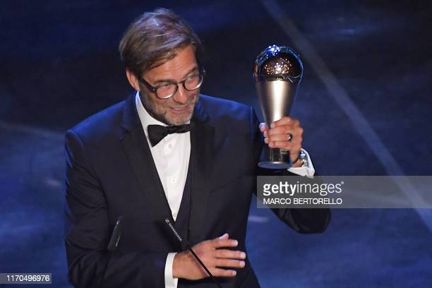 TOPSHOT Liverpool coach Germany's Juergen Klopp reacts after winning the trophy for the Best FIFA Men's Coach of 2019 Award during The Best FIFA...