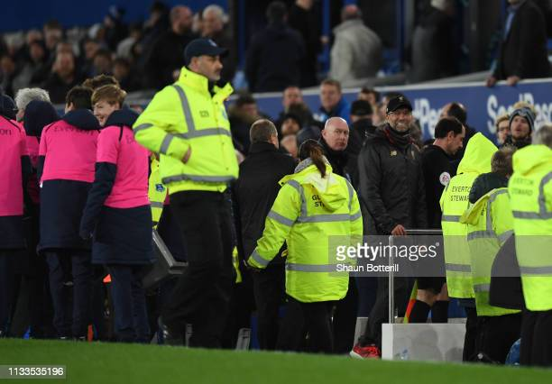 Liverpool coach Jurgen Klopp leaves the pitch after the Premier League match between Everton FC and Liverpool FC at Goodison Park on March 03 2019 in...
