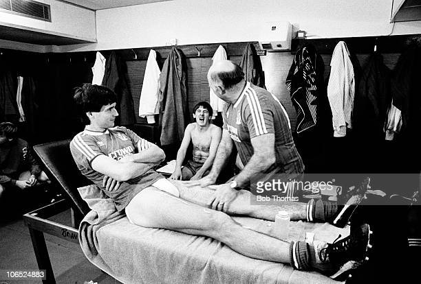 Liverpool coach Ronnie Moran enjoys a joke with Peter Beardsley whilst massaging captain Alan Hansen before the Division One football match with...