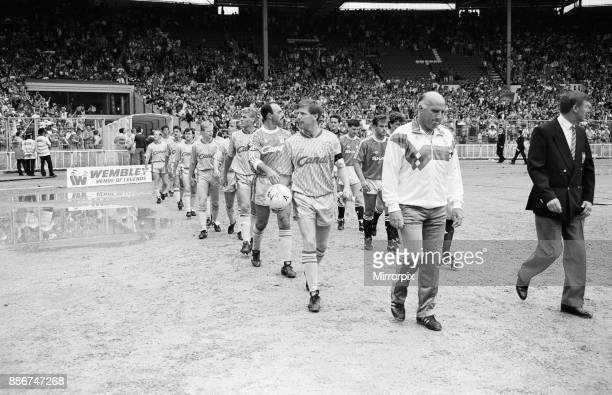 Liverpool coach Ronnie Moran walks out on to the pitch at Wembley as he leads his side out for the Charity Shield match against Manchester United,...