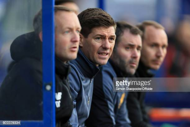 Liverpool coach Steven Gerrard looks on from the dugout during the UEFA Youth League Round of 16 match between Liverpool and Manchester United at...