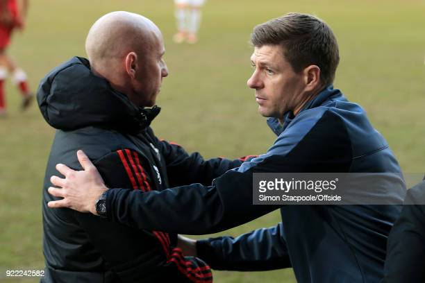 Liverpool coach Steven Gerrard shakes hands with Man Utd coach Nicky Butt at the end of the UEFA Youth League Round of 16 match between Liverpool and...