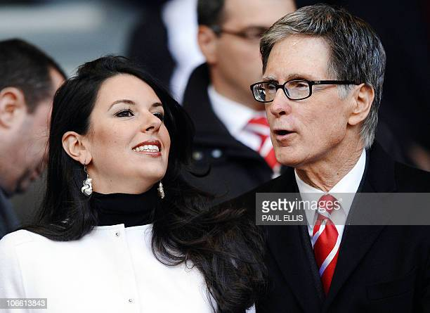 Liverpool coowner John Henry and his partner Linda Pizzuti arrive before their English Premier League football match against Chelsea at Anfield in...