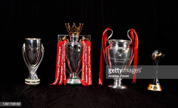 Liverpool current trophies the Super Cup trophy Premier League trophy Champions League trophy and World Club Cup trophy at Anfield on July 28 2020 in...