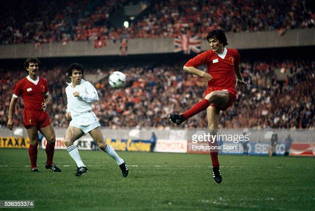 Liverpool defender Alan Hansen clears the ball watched by Graeme Souness and Juantito of Real Madrid during the UEFA European Cup Final at the Parc...