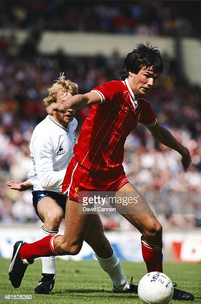 Liverpool defender Alan Hansen holds off the challenge of Spurs striker Steve Archibald during the 1982 FA Charity Shield at Wembley Stadium on...