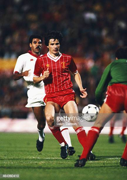 Liverpool defender Alan Hansen shepherds the ball back to goalkeeper Bruce Grobbelaar despite the attentions of AS Roma player Toninho Cerezo during...