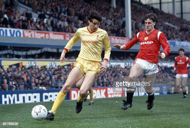 Liverpool defender Alan Hansen shields the ball from Manchester United's Mark Hughes during the FA Cup Semi-Final at Goodison Park, 13th April 1985....