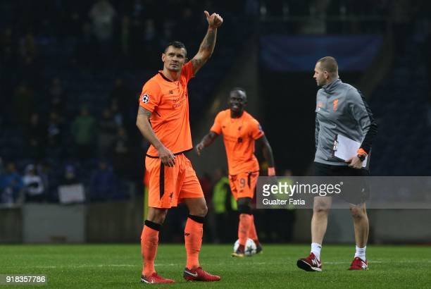 Liverpool defender Dejan Lovren from Croatia celebrates the victory at the end of the UEFA Champions League Round of 16 First Leg match between FC...