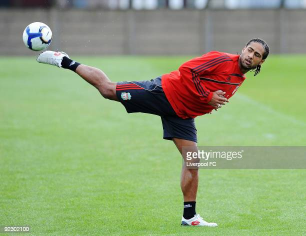 Liverpool defender Glen Johnson stretches for the ball during a training session at the team's Melwood Training Ground on October 23 in Liverpool...