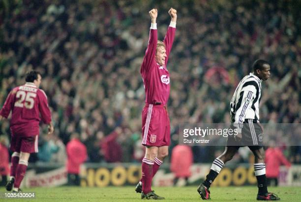 Liverpool defender John Scales celebrates on the final whistle as Faustino Asprilla looks on after the 43 Premier League match between Liverpool and...