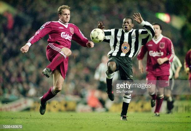 Liverpool defender John Scales challenges Newcastle forward Faustino Asprilla during the 4-3 Premier League match between Liverpool and Newcastle...