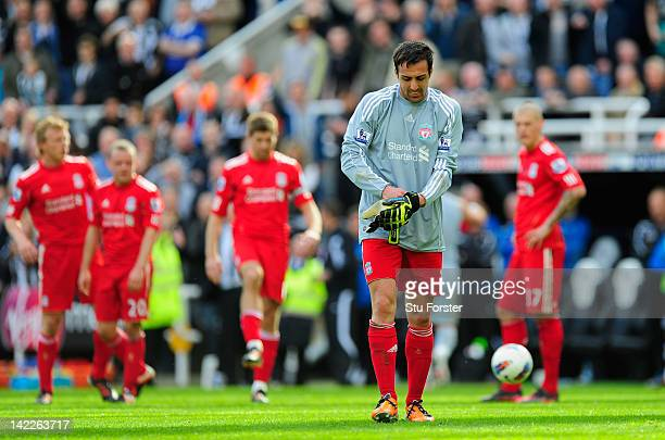 Liverpool defender Jose Enrique takes over in goal after keeper Pepe Reina was sent off by referee Martin Atkinson during the Barclays Premier League...
