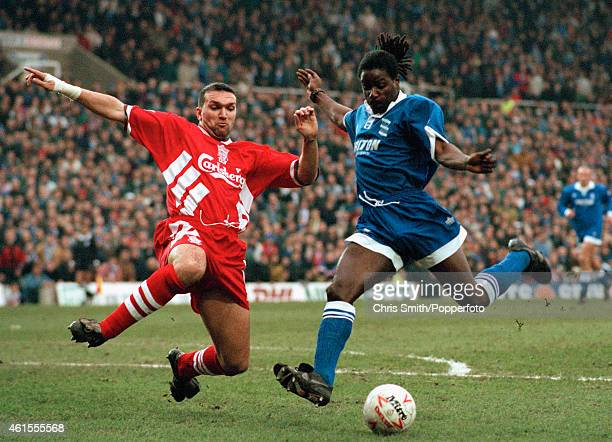 Liverpool defender Neil Ruddock jumps in to tackle Birmingham City striker Ricky Otto during the FA Cup 3rd round match between Birmingham City and...