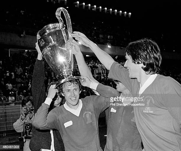 Liverpool defender Phil Neal wearing the trophy on his head following their 10 victory over Real Madrid in the European Cup Final at the Parc des...