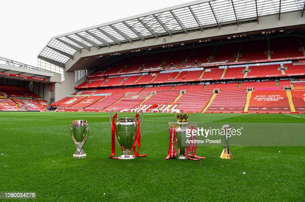 Liverpool display the four trophies that they currently hold UEFA Super Cup The Premier League UEFA Champions League and FIFA World Club Cup at...