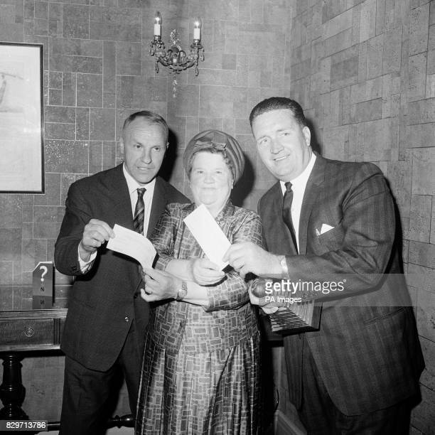 Liverpool Exchange MP Bessie Braddock presents the two winning managers Liverpool's Bill Shankly and Celtic's Jock Stein with their cheques for 500...