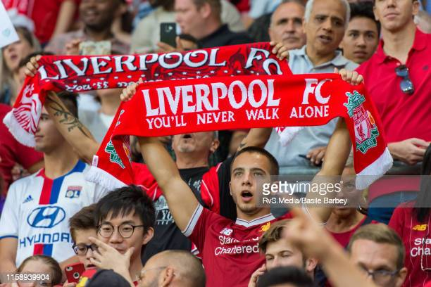 Liverpool fan cheers during the Pre-Season Friendly match between Liverpool FC and Olympique Lyonnais at Stade de Geneve on July 31, 2019 in Geneva,...