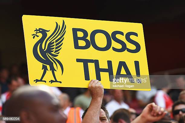 Liverpool fan displays a sign during the Premier League match between Arsenal and Liverpool at Emirates Stadium on August 14 2016 in London England