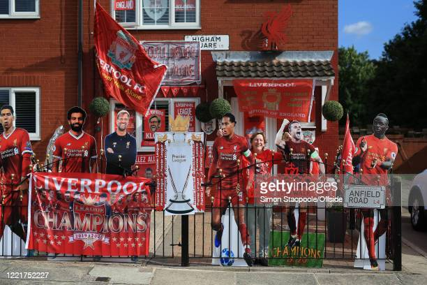 Liverpool fan Emily Farley poses outside her home which is decorated in club flags banners and paraphernalia before the Premier League match between...