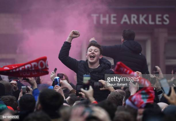 Liverpool fan enjoys the pre match atmosphere as the team bus arrives prior to the UEFA Champions League Quarter Final Leg One match between...